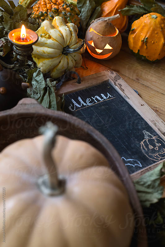 Tray decorated for Halloween with pumpkins, dry grapevine leaves and chalkboard menu by Jovana Milanko for Stocksy United
