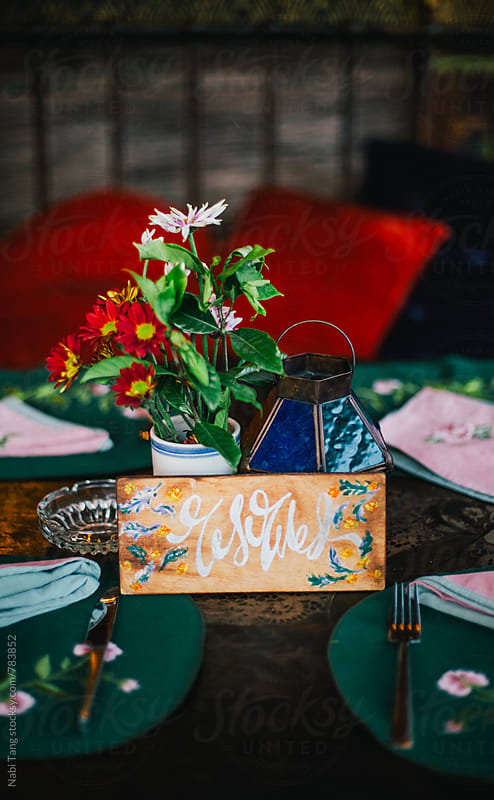 Reserved table at colorful Spainish restaurant by Nabi Tang for Stocksy United
