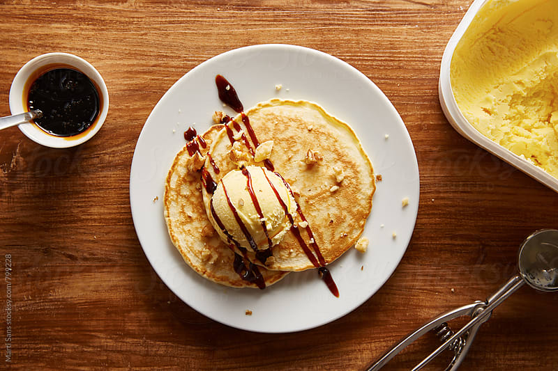 Vanilla ice-cream and chocolate syrup pancakes  by Martí Sans for Stocksy United