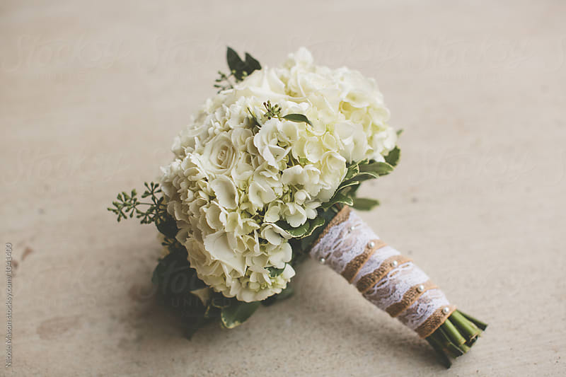 bridal bouquet of white flowers by Nicole Mason for Stocksy United