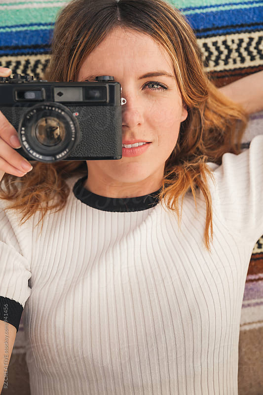 Stylish woman with vintage camera. by Robert Zaleski for Stocksy United