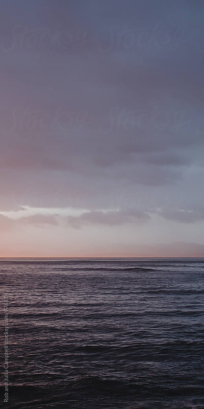 Sunrise over the pacific ocean and waves by Rob and Julia Campbell for Stocksy United