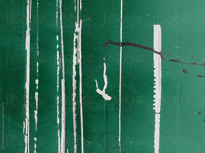 Painted green wall with scratch marks, close up by Paul Edmondson for Stocksy United
