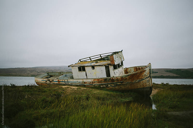 Shipwreck on a cloudy day by Christian Gideon for Stocksy United