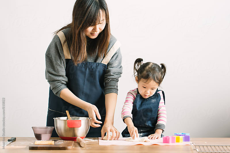 Mother and toddler girl making cookies by Maa Hoo for Stocksy United