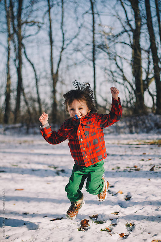 Young Boy Happily Jumping in the Air by Kevin Keller for Stocksy United