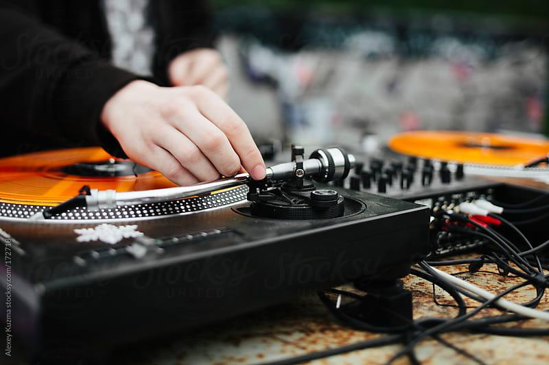 DJ at the garage club by Alexey Kuzma for Stocksy United