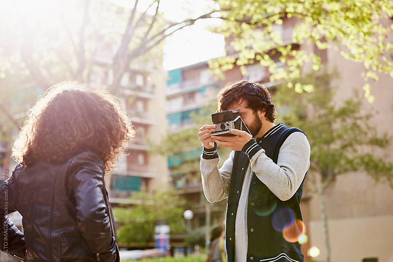 Man Photographing Woman In City by ALTO IMAGES for Stocksy United
