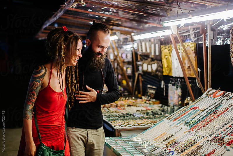 Couple Shopping at the Night Market by Mosuno for Stocksy United