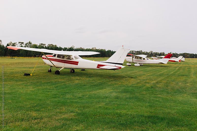 Planes parked at a small rural airport. by Lucas Saugen for Stocksy United