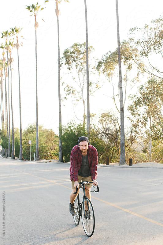 Young Man on a Bicycle by Caleb Thal for Stocksy United