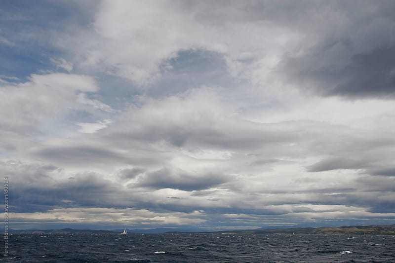 Skyscape with waving clouds above the tempestous sea by Ferenc Boros for Stocksy United