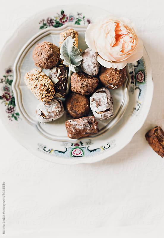 Stylized plate of Belgian chocolate truffles by Natasa Kukic for Stocksy United