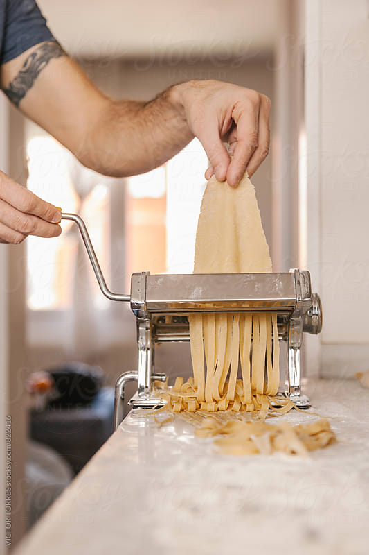 Family Preparing Pasta at Home by Victor Torres for Stocksy United