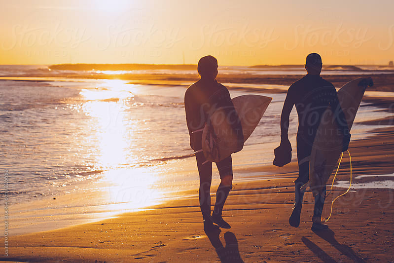 Couple of surfers after a session by Leandro Crespi for Stocksy United