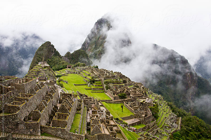 Machu Picchu ruins view with mountains and low clouds in Peru by Alejandro Moreno de Carlos for Stocksy United