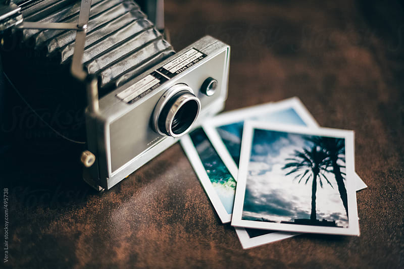 Old camera and Polaroid by Vera Lair for Stocksy United