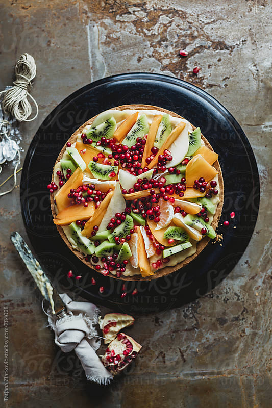 Homemade tart with fruit by Tatjana Ristanic for Stocksy United