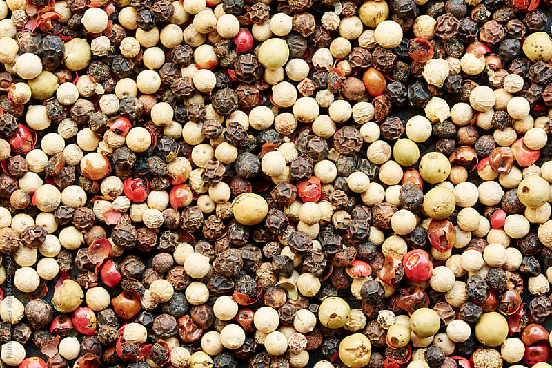 Multi-colored peppercorns by Harald Walker for Stocksy United