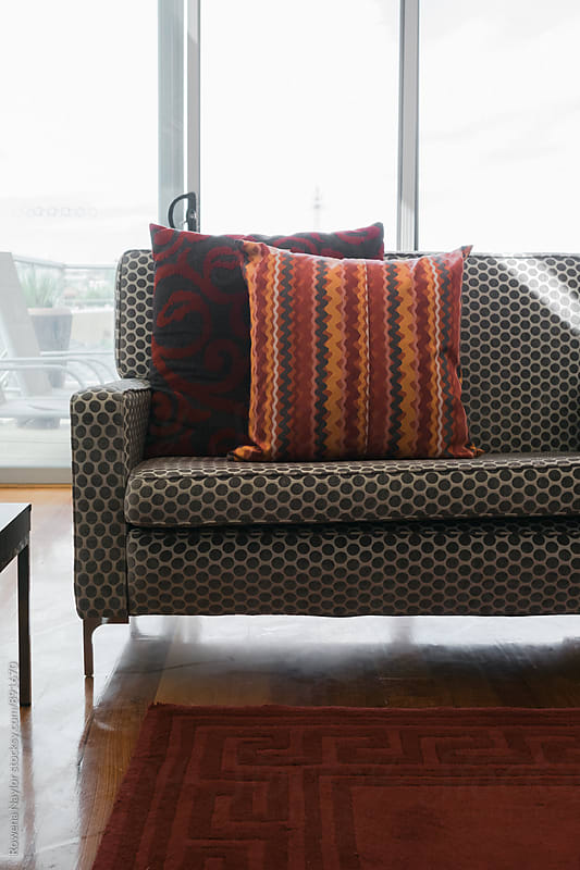 Sofa with soft furnishing by Rowena Naylor for Stocksy United