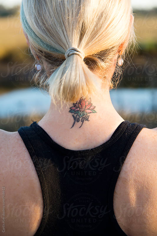 Female with lotus tattoo on her neck by Curtis Kim for Stocksy United