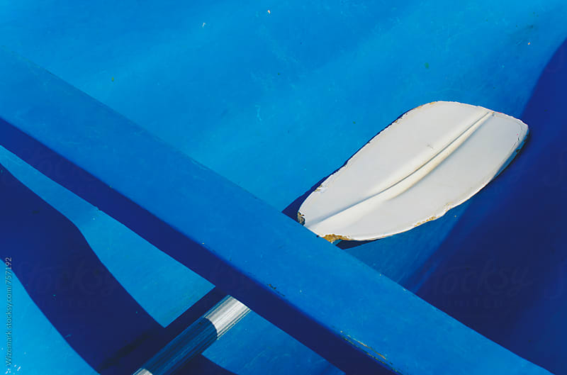 Detail of a white paddle in a blue boat by Wizemark for Stocksy United