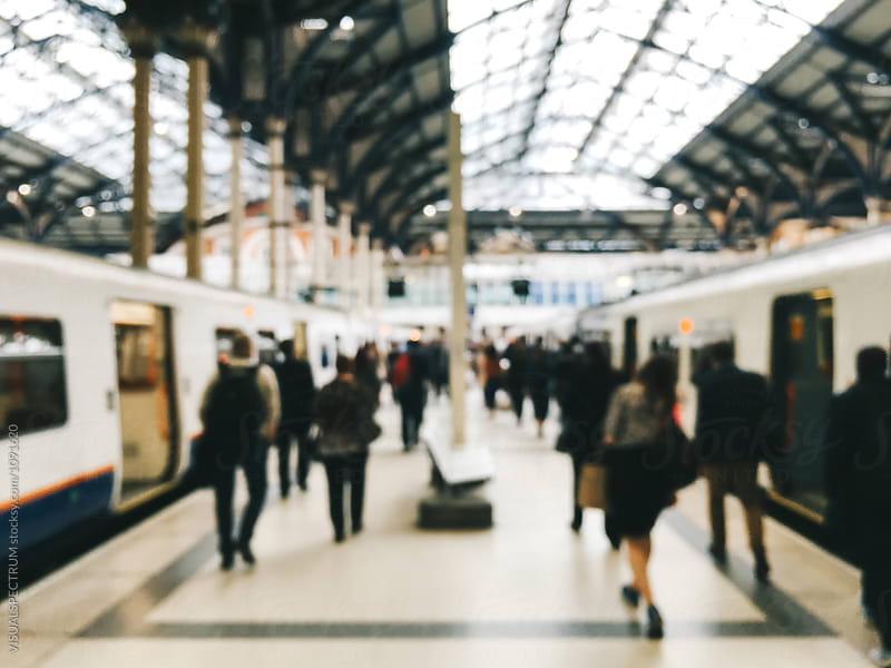 Defocused Shot of Travelers Arriving in London Railway Station by Julien L. Balmer for Stocksy United