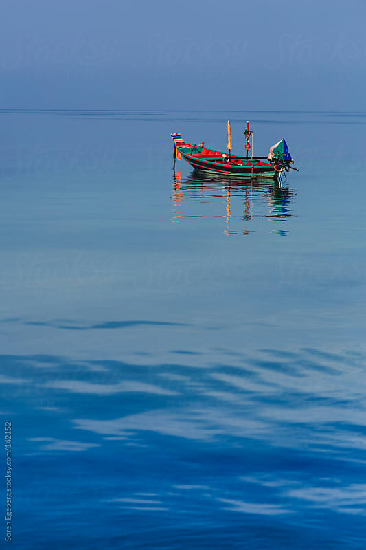 Blue ocean view with flat sea and small boat on the horizon by Soren Egeberg for Stocksy United