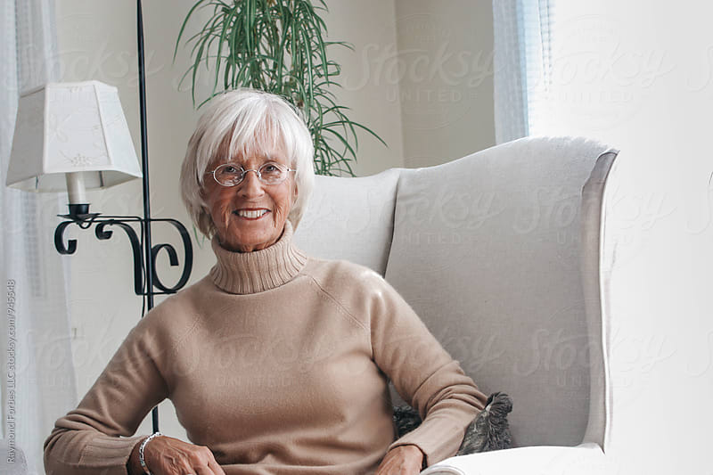 Portrait of Senior Woman at Home by Raymond Forbes LLC for Stocksy United