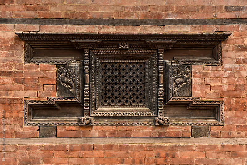 Traditional medieval nepali window on a palace, Kathamandu by Bisual Studio for Stocksy United