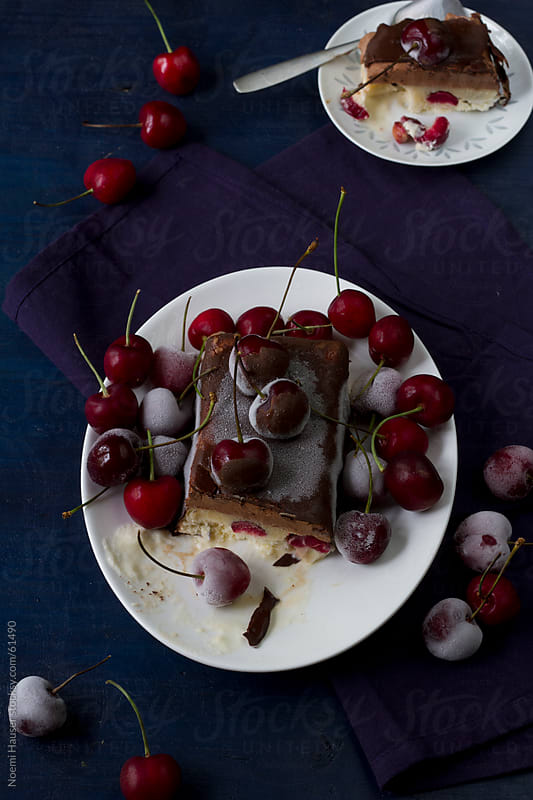 Chocolate and vanilla ice cream cake with frozen cherries by Noemi Hauser for Stocksy United