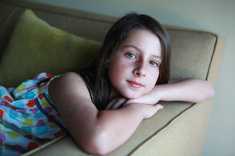 Pre-teen portrait of brown haired girl with freckles by Dina Giangregorio for Stocksy United