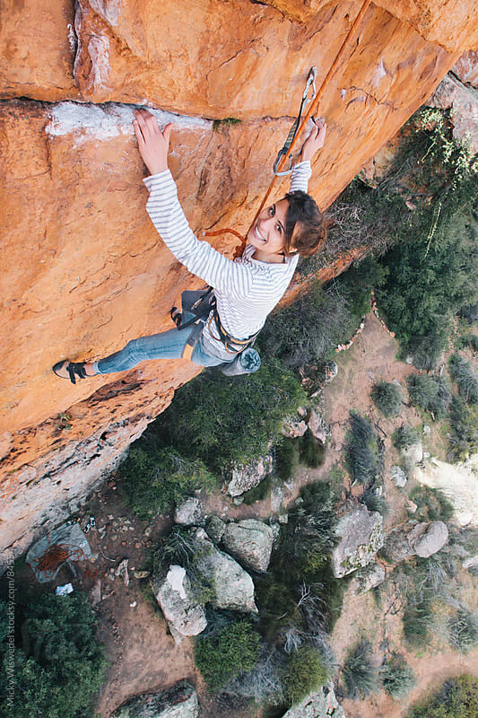 Woman beginner rock climber top roping a route by Micky Wiswedel for Stocksy United