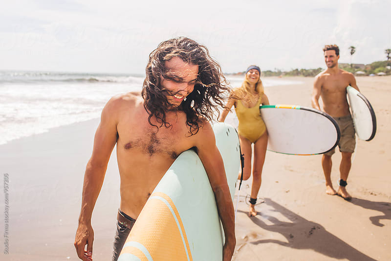 Surfers by Studio Firma for Stocksy United