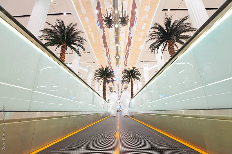 UAE, United Arab Emirates, Dubai, Dubai International Airport, Terminal 3, Moving walkway in the new Arrivals Hall by Gavin Hellier for Stocksy United
