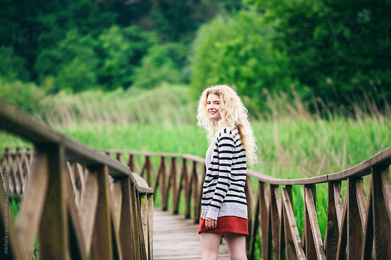 Young woman in nature by michela ravasio for Stocksy United