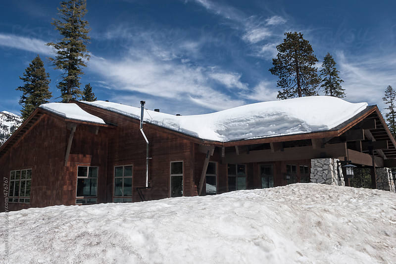 Mountain lodge buried in snow by Adam Nixon for Stocksy United