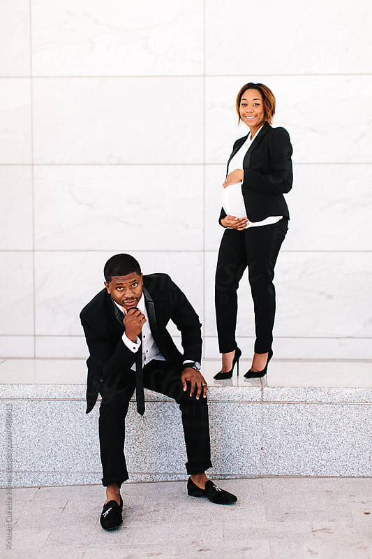 A stylish and modern husband and wife by Kristen Curette Hines for Stocksy United