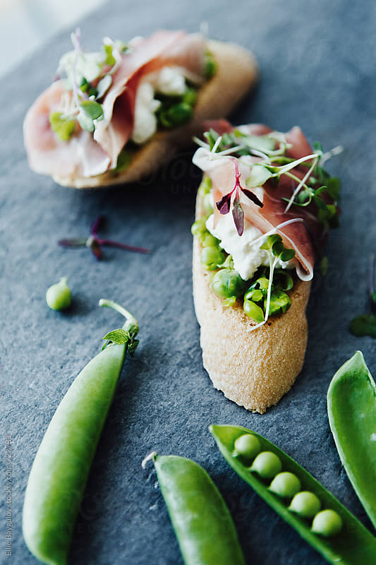 Spring pea crostini by Ellie Baygulov for Stocksy United