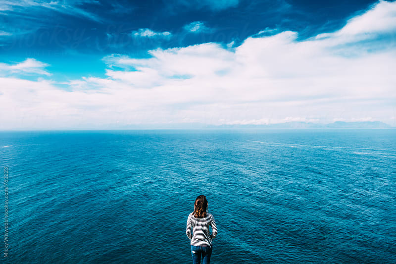 Woman overlook an expansive sea view from above by Micky Wiswedel for Stocksy United