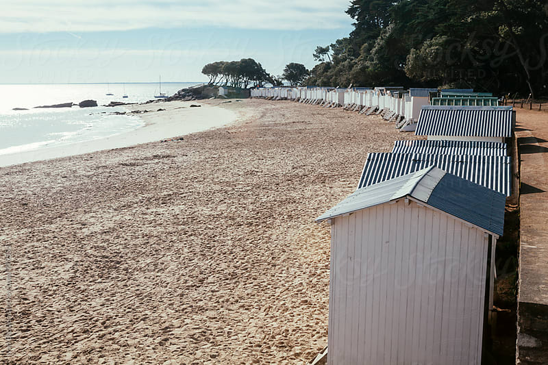 Beach huts on Noirmoutier Island beach in France by Ivan Bastien for Stocksy United