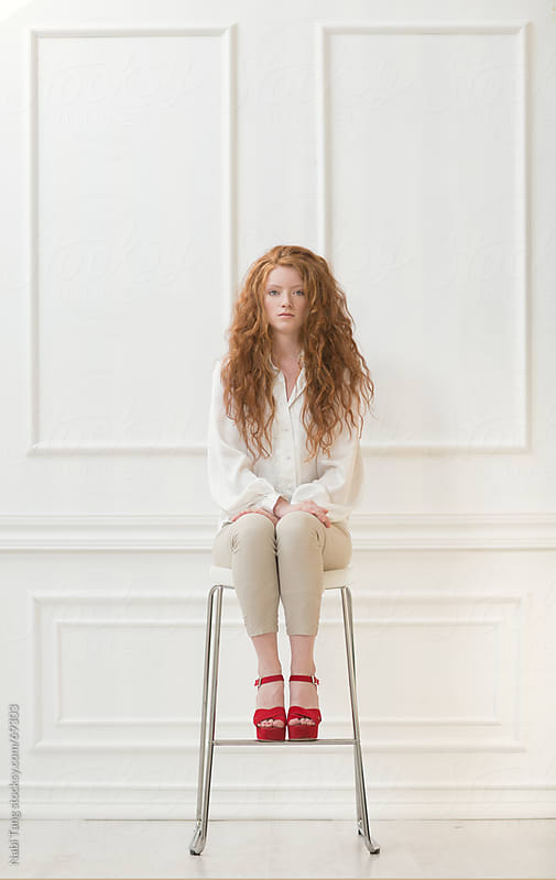 Beautiful red hair girl in white room by Nabi Tang for Stocksy United