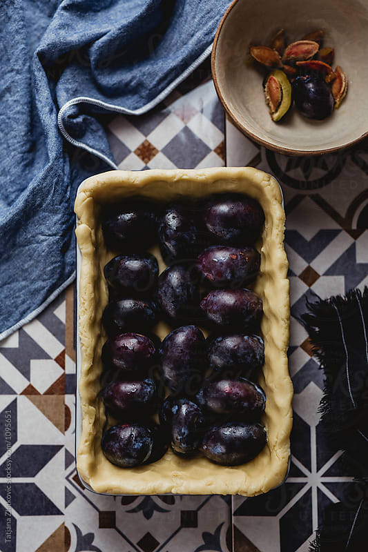 Making plum pie by Tatjana Zlatkovic for Stocksy United