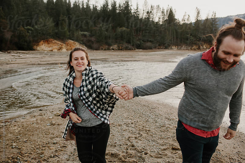 Daniel and Kate on the Lake by Sidney Morgan for Stocksy United