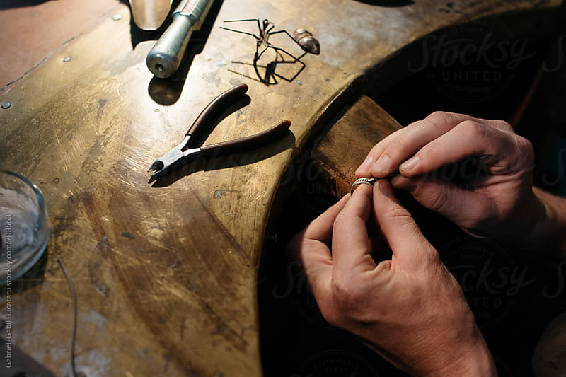 Jeweler repairing a ring by Gabriel (Gabi) Bucataru for Stocksy United
