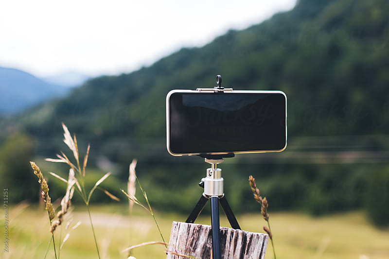 Cell phone on tripod by Zocky for Stocksy United