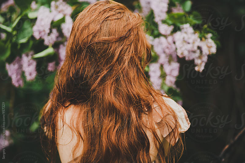 Back view on anonymous woman with redhair by Sergey Filimonov for Stocksy United
