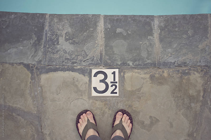 Toes pool side by Lucas Saugen for Stocksy United