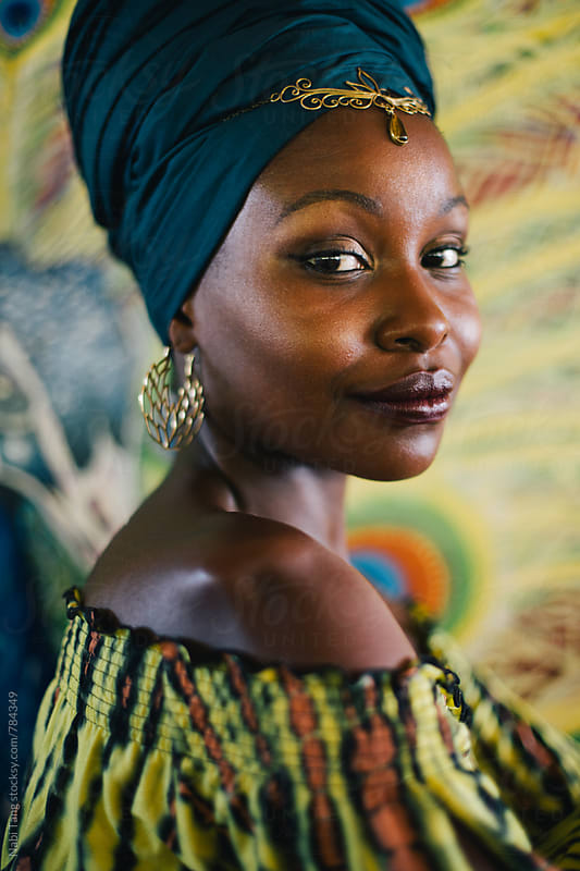 Beautiful african hippie portrait in yellow dress and blue turban by Nabi Tang for Stocksy United