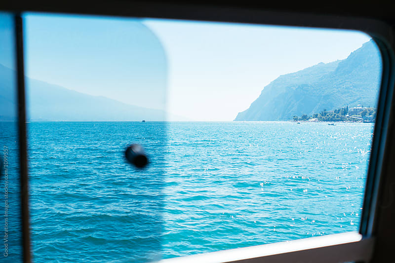 Looking the lake through a window by Good Vibrations Images for Stocksy United